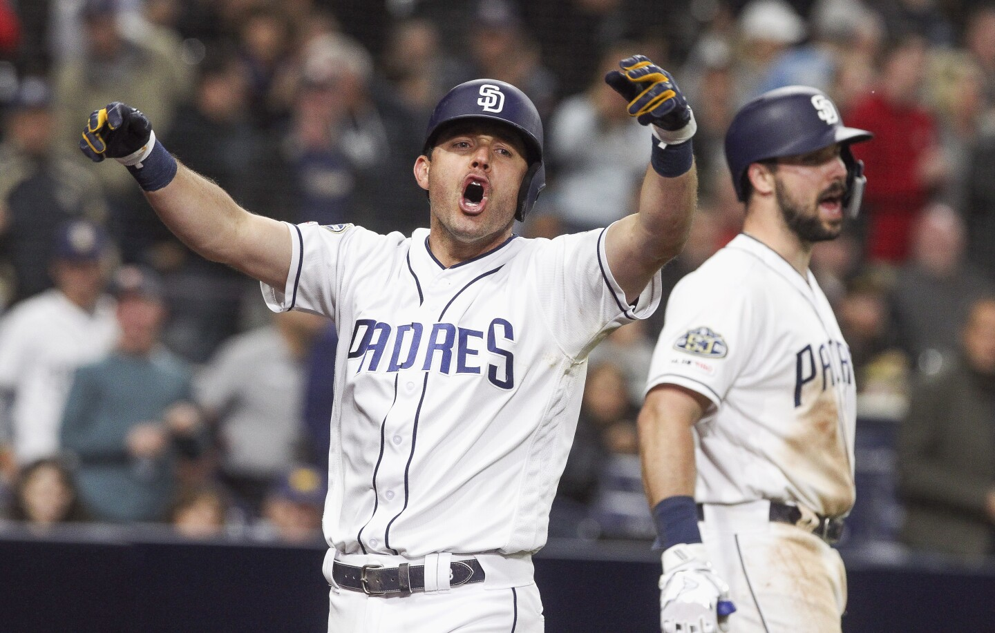 The Padres' Ian Kinsler lets out a yell as he celebrates his three-run home run in the sixth inning against the Pirates at Petco Park on Thursday, May 16, 2019 in San Diego, California.