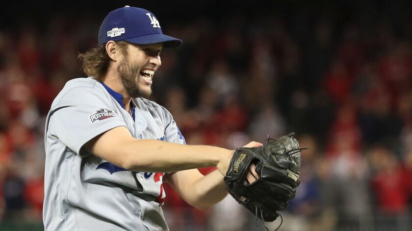 Clayton Kershaw is overjoyed after the Dodgers defeated the Washington Nationals in Game 5 of the National division series on Oct. 13, 2016.