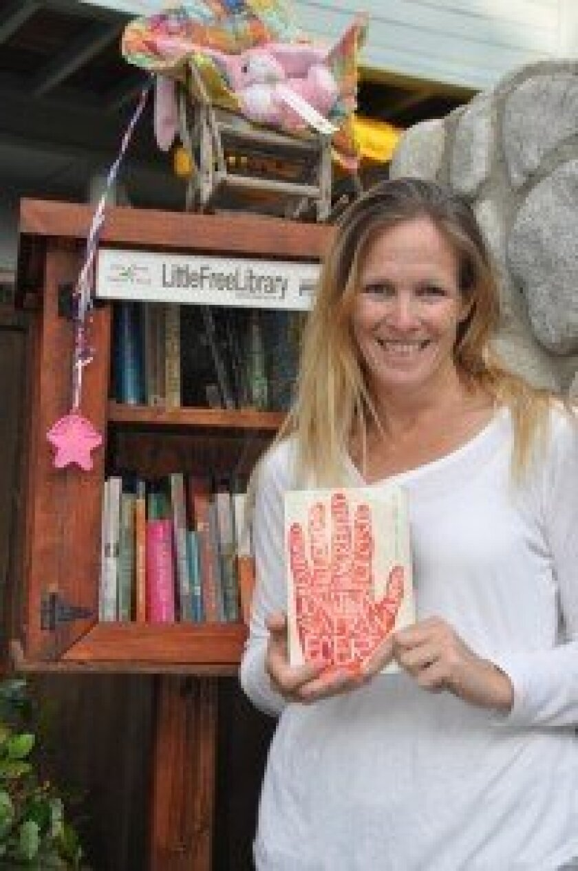 Kate Zimmer at the Little Free Library in Del Mar. Courtesy photo