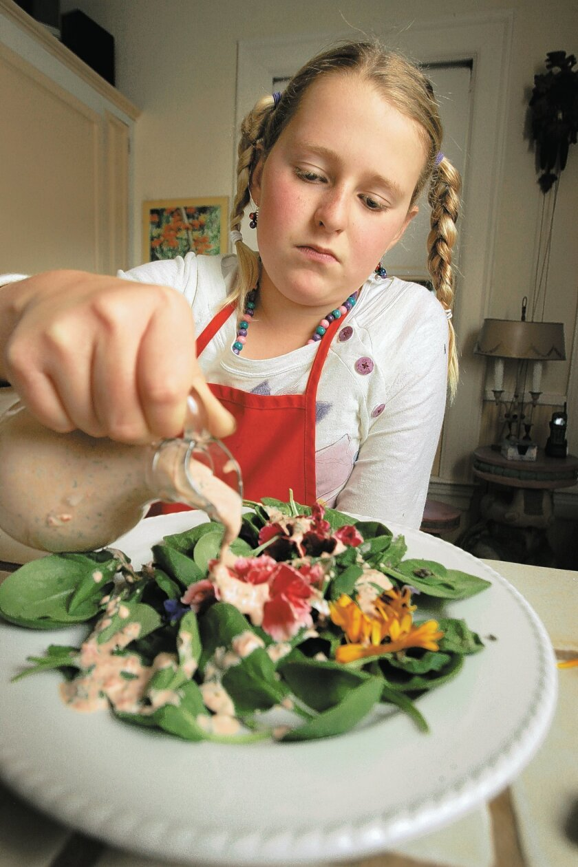 Cerise Cox, 9, puts the finishing touches on her Purple Carrot, Lavender With Buttermilk Dressing.