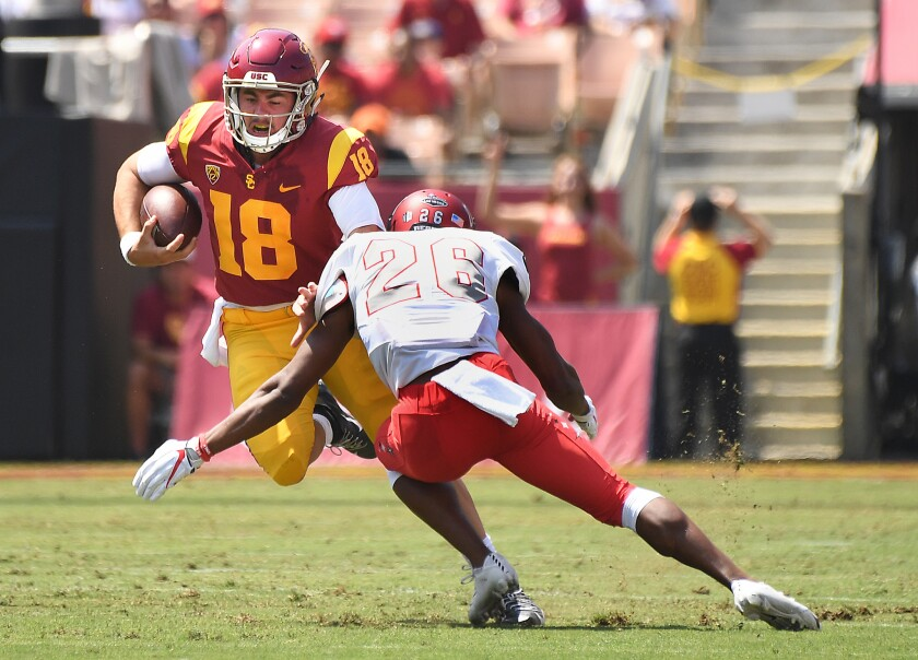 USC quarterback JT Daniels scrambles to evade UNLV defensive back Jocquez Kalili during the Trojans' 43-21 victory Saturday at the Coliseum.