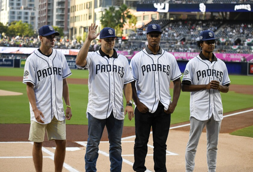 Padres 2019 draft picks, from left, Matt Brash, Logan Driscoll, Joshua Mears and CJ Abrams, stand at home plate before a baseball game between the San Diego Padres and the Washington Nationals at Petco Park on June 8.