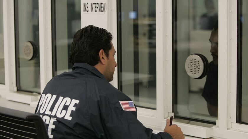 ICE officers interrogate newly admitted prisoners at the downtown San Diego Central Jail