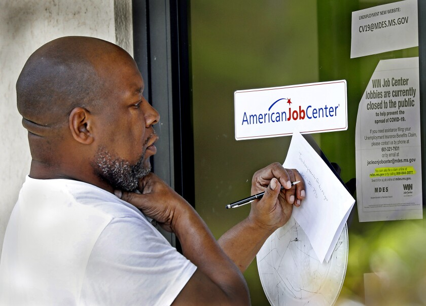 A resident copies down the Mississippi unemployment benefit website.