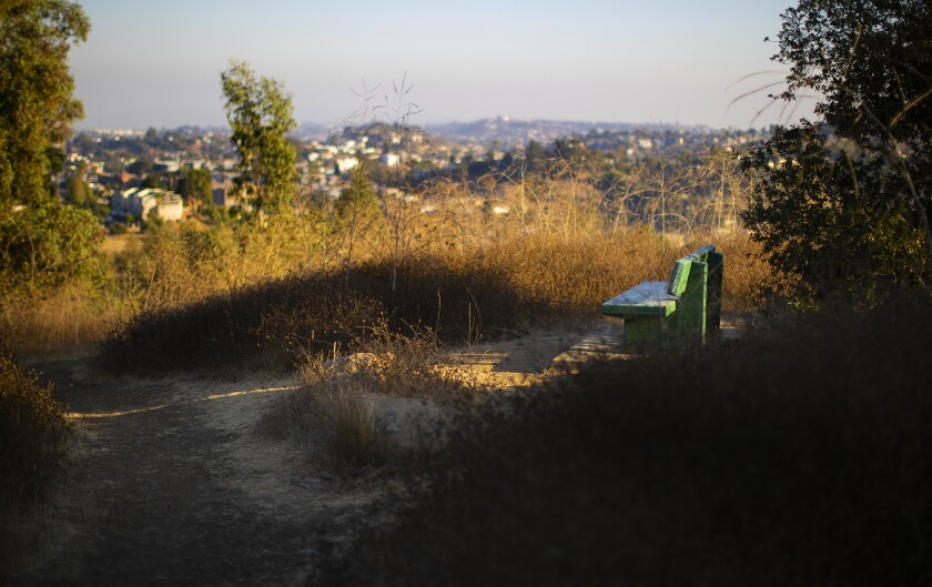 One of the green park benches overlooking Los Angeles on the way from Debs Park back to Rose Hill Park.