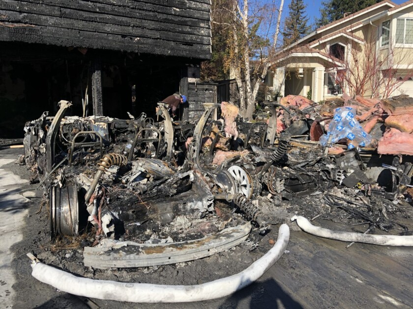 The remains of a pair of Teslas that had been parked in the garage of Jorgen and Carolyn Vindum of San Ramon.