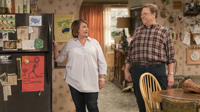 This image released by ABC shows Roseanne Barr, left, and John Goodman in a scene from the comedy se