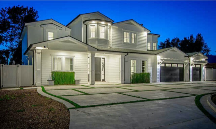 Built in 2018, the two-story traditional-style home boasts a black-and-white color scheme on the inside and outside.