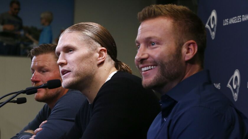 THOUSAND OAKS, CALIF. - MAR. 21, 2019. Linebacker Clay Matthews is flanked by Rams General Manager