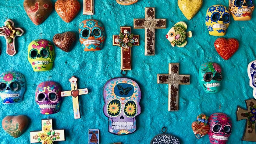 Colorful masks, crosses and hearts on display in the boho-chic surf town of Sayulita.