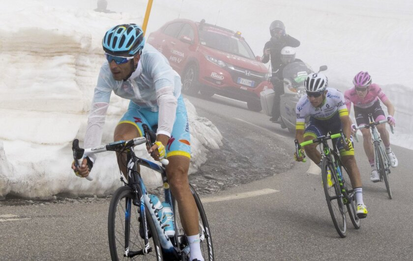 From left, Italian rider Vincenzo Nibali of Astana Pro Team, Colombia's Vincenzo Nibali of Orica GreenEdge and Dutch rider Steven Kruijswijk of Team Lotto Jumbo pedal during the 19th stage of the Cycling Tour of Italy from Pinerolo to Risoul, Friday, May 27, 2016. (Claudio Peri/ANSA via AP)