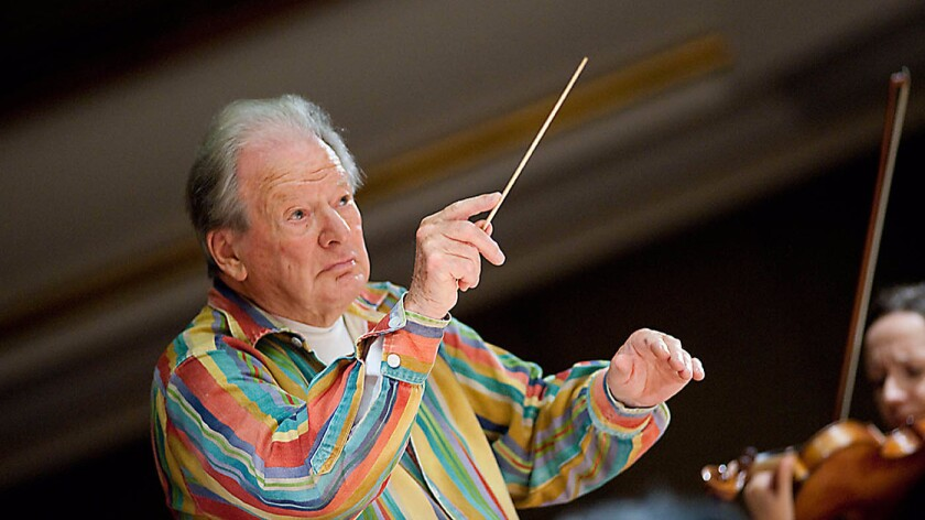 Neville Marriner conducting an orchestra.