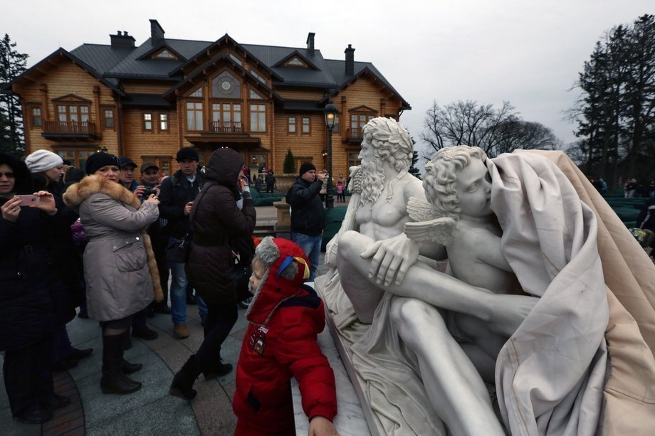 "Ordinary Ukrainians got their first look recently at the way despised ex-President Viktor Yanukovich really lived; not the modest house with the cramped office shown to a TV audience two years ago but an opulent compound outside Kiev with a golf course and a swimming pool. OK, he was a president, but a taxpayer-financed car collection, zoo and, uh, a ""pirate"" ship? As thousands of curious citizens streamed through the gates of the ""presidential"" Mezhgorye residence -- initially guarded by anti-government protesters instead of police -- most seemed more interested in taking pictures than taking the furniture. ""I didn't know this handsome, humble man I saw on television on a daily basis was a czar,"" Alla Petrenko, a 59-year-old pensioner, told The Times as she stared through a French window of Yanukovich's three-story home at a winding staircase with marble steps. ""We did not expect anything like this. It is really extensive and all done with our money, the money of ordinary people. It really is too much for one person,"" Serhiy Remezovsky told the Sydney Morning Herald. Yeah, one extremely well-connected person, apparently -- who allegedly acquired the land from the state, via front companies, according to The Times. So what will happen to the expansive estate and grounds whose owner is now on the run? One visitor, awestruck but angry, urged that it all be turned into something ""recreational for the children of Ukraine."" Viktor, wherever you are, are you listening? Above: Thousands of Ukrainians flocked to President Viktor Yanukovich's abandoned residence near Kiev."
