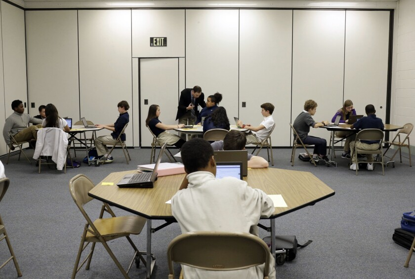 Seventh-grade students take part in a trial run of a new state assessment test on laptop computers at Annapolis Middle School in Annapolis, Md., in February.