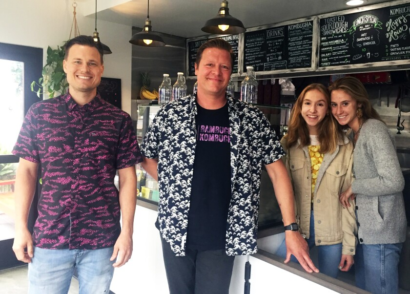 Live Culture Cafe partners Patrick Otterson, left, and Michael ZonFrilli with employees Izzy Brown and Olive Wheadon in their new Leucadia restaurant.