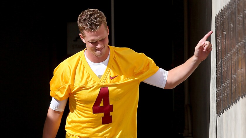 Quarterback Max Browne heads to Howard Jones Field on the USC campus for the first summer practice.