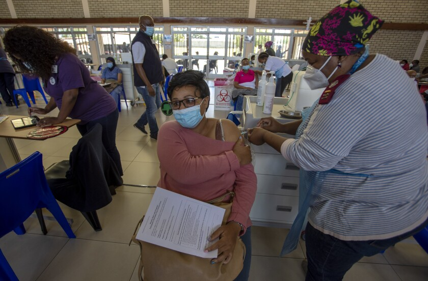 Sinkameng Moilwa, a professional nurse in a dental department, receives a dose of Johnson & Johnson COVID-19 vaccine from a health staff member during a vaccination day for healthcare workers at a vaccination centre at Chris Hani Baragwanath Academic Hospital in Johannesburg, South Africa, Friday, March 26, 2021. (AP Photo/Themba Hadebe)