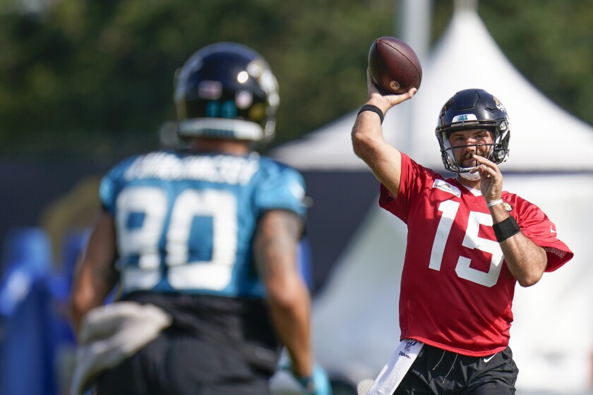 Jacksonville Jaguars quarterback Gardner Minshew (15) throws a pass to tight end James O'Shaughnessy (80) during NFL football practice, Friday, Aug. 6, 2021, in Jacksonville, Fla. (AP Photo/John Raoux)