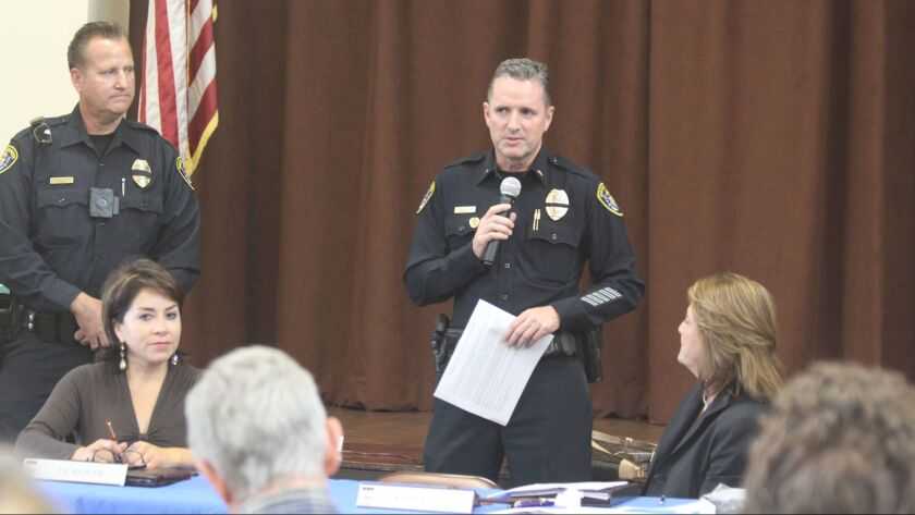 San Diego Police Lt. Robert Daun (center) and Community Relations Officer Larry Hesselgesser discuss personnel changes in the department with members of the La Jolla Town Council.