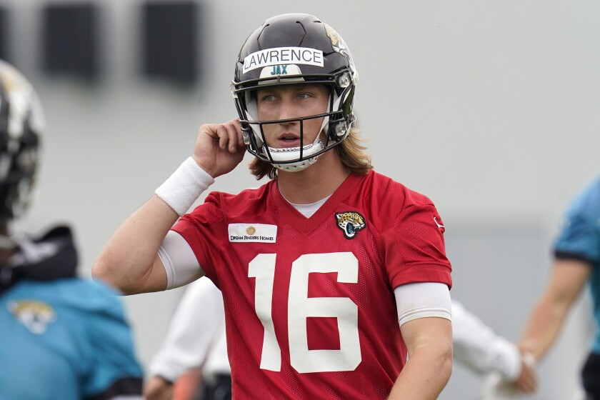 Jacksonville Jaguars quarterback Trevor Lawrence (16) takes a break during an NFL football practice, Monday, June 14, 2021, in Jacksonville, Fla. (AP Photo/John Raoux)