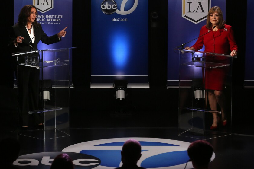 U.S. Senate candidates Kamala Harris, left, points a finger toward Loretta Sanchez during their debate at Cal State L.A. on Wednesday, Oct. 5.