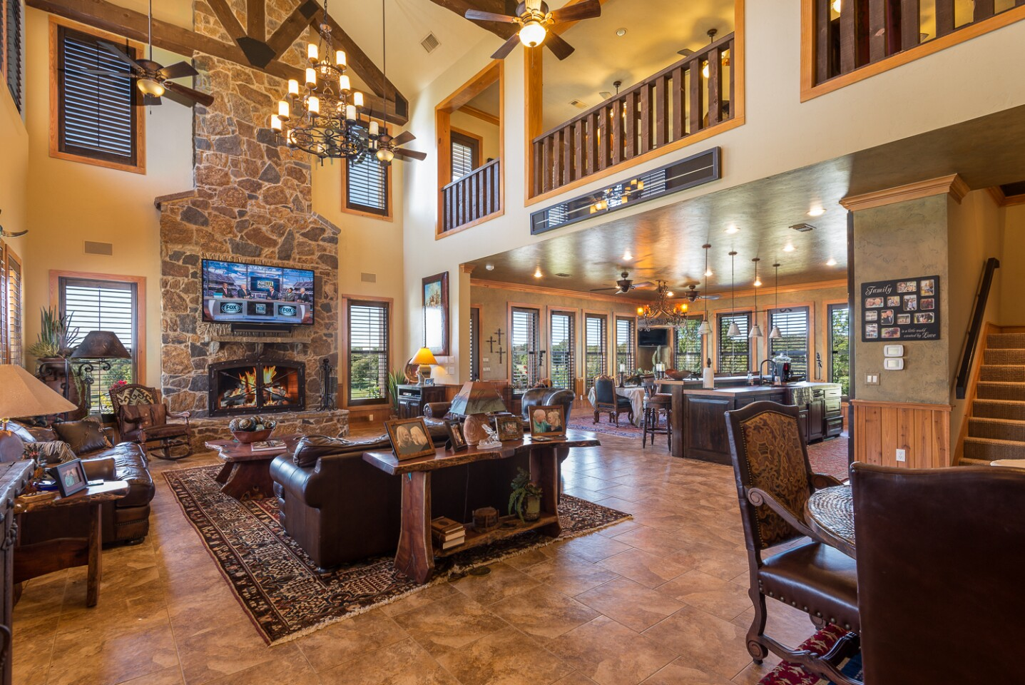 The fully operational cattle and horse ranch holds an 8,600-square-foot home, an entertainer's patio with a pool, five horse barns, eight lakes and ponds and an office with a kitchen.