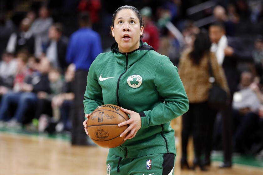 Boston Celtics assistant coach Kara Lawson on the court during warmups before a game against the Philadelphia 76ers.