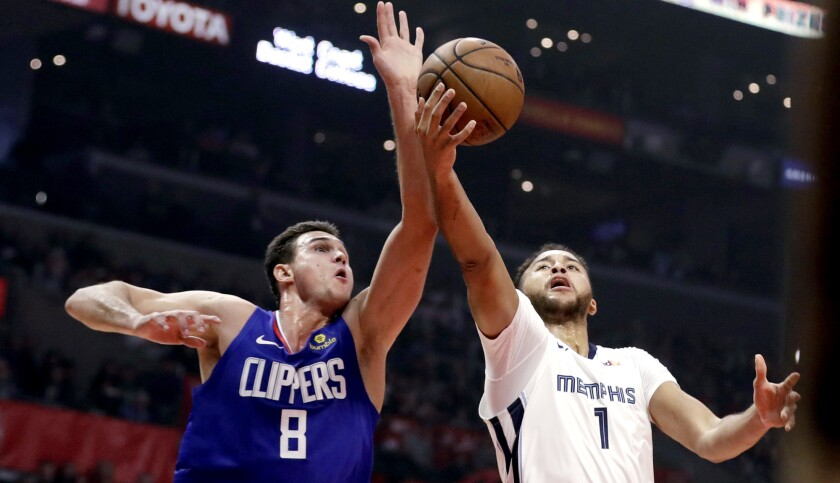 Clippers forward Danilo Gallinari prepare to block a shot by Grizzlies forward Kyle Anderson during the first half Friday.
