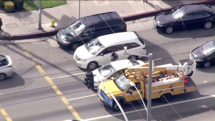 A cameraman approached a driver during an LAPD pursuit Wednesday.
