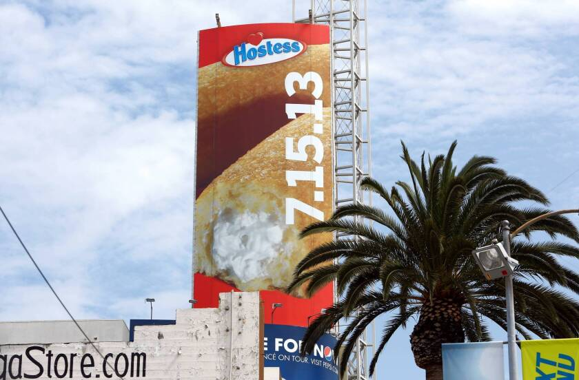 A towering advertisement at Hollywood Boulevard and Highland Avenue in Hollywood promotes the return of the Hostess Twinkie.