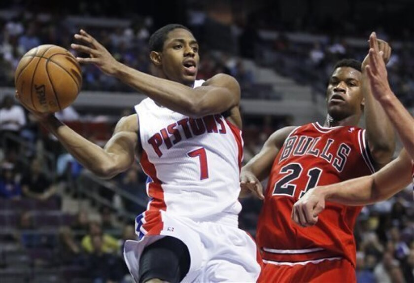 FILE - In this April 7, 2013, file photo, Detroit Pistons guard Brandon Knight (7) looks to pass against Chicago Bulls guard Jimmy Butler (21) during an NBA basketball game in Auburn Hills, Mich. A person familiar with the deal tells The Associated Press that the Pistons have acquired point guard Brandon Jennings from the Milwaukee Bucks for Knight and two prospects. (AP Photo/Duane Burleson, File)
