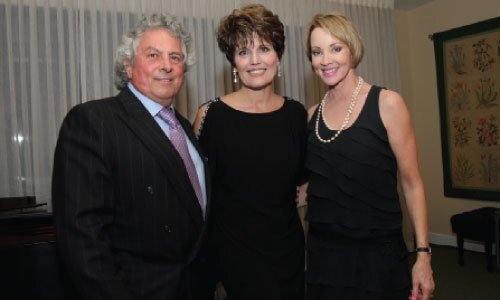 """Broadway veteran and Emmy Award-winning actress Lucie Arnaz sang at the """"Bow Tie & Pearls"""" gala celebrating North Coast Repertory Theatre's 30th anniversary. The event was held April 22 at the Rancho Santa Fe Garden Club. Honorary Event Chairs Bertrand and Denise Hug with Lucie Arnaz (center). Photo/Jon Clark"""