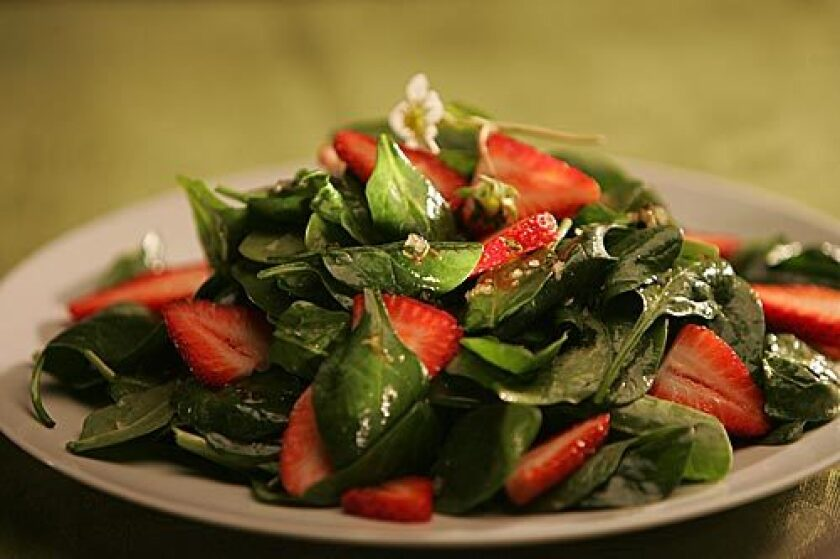 SEASONAL: Spinach and strawberry salad with thyme-infused vinaigrette.