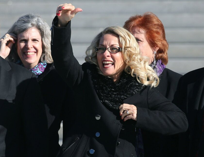 Rebecca Friedrichs waves to supporters after arguments at the US Supreme Court January 11, 2016 in Washington, DC. County Republicans gave her the Torch of Freedom award on Saturday.