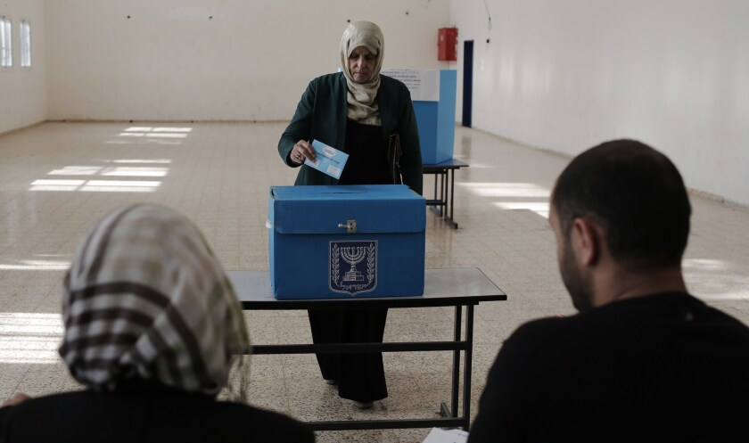 An Israeli citizen casts her ballot at a polling station in the northern town of Umm al-Fahm on March 17.