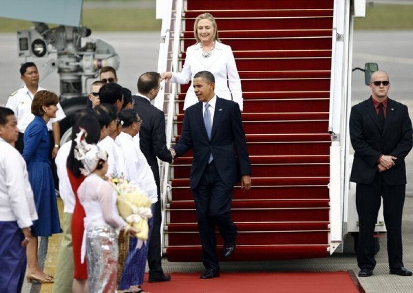 President Obama shakes hands with U.S. Ambassador Derek J. Mitchell at the airport in Yangon, Myanmar, on Monday.