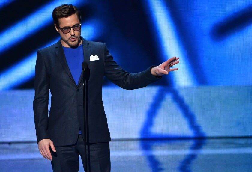 Robert Downey Jr. accepts the favorite movie actor award at the 2015 People's Choice Awards.