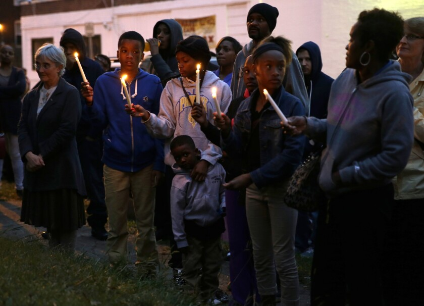People gather to remember Vonderrit D. Myers, 18, fatally shot by a police officer in St. Louis on Wednesday.