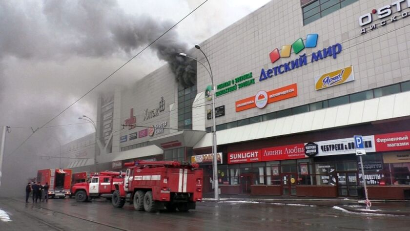 Firefighters at a shopping mall on fire in the Siberian city of Kemerovo, Russia, on March 25, 2018.