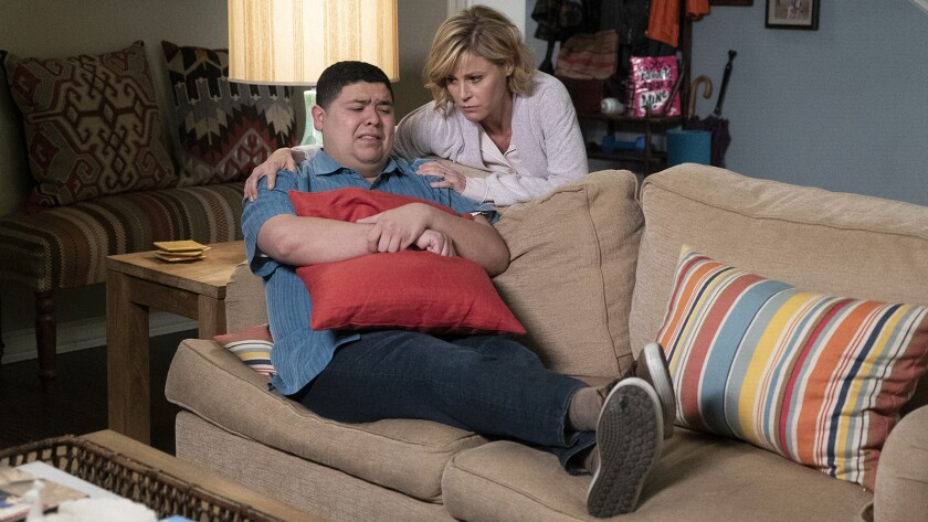 """Rico Rodriguez and Julie Bowen in """"Modern Family"""" on ABC."""