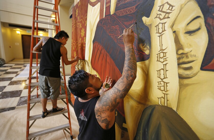 LOS ANGELES, CA - SEPTEMBER 13, 2017: Artists Dario Canul, right, and Cosijoesa Cernas, left, from t
