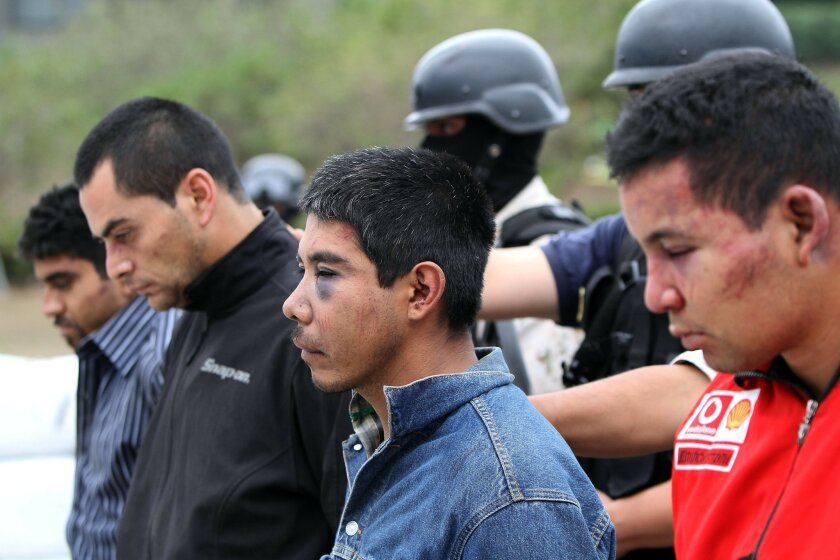 "Suspects lined up for the news media by the authorities in Tijuana. Gen. Alfonso Duarte Múgica, commander of the Mexican Army's Second Military Zone in Baja California, said the bust ""represents a strong blow to the operational and financial structure of criminal groups here in Tijuana."""