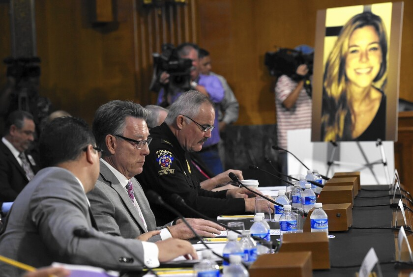 Jim Steinle, second from left, father of Kate Steinle (in photo at right), testifies at a Senate hearing on the administration's immigration enforcement policies. Kate Steinle was killed on a San Francisco waterfront walkway, allegedly by a man who had been deported several times.