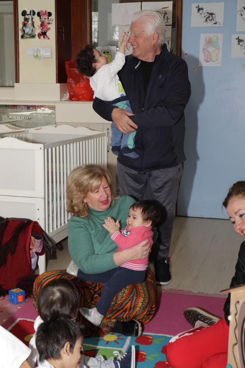 Linda and Charles Van Kessler at a Serbian orphanage.