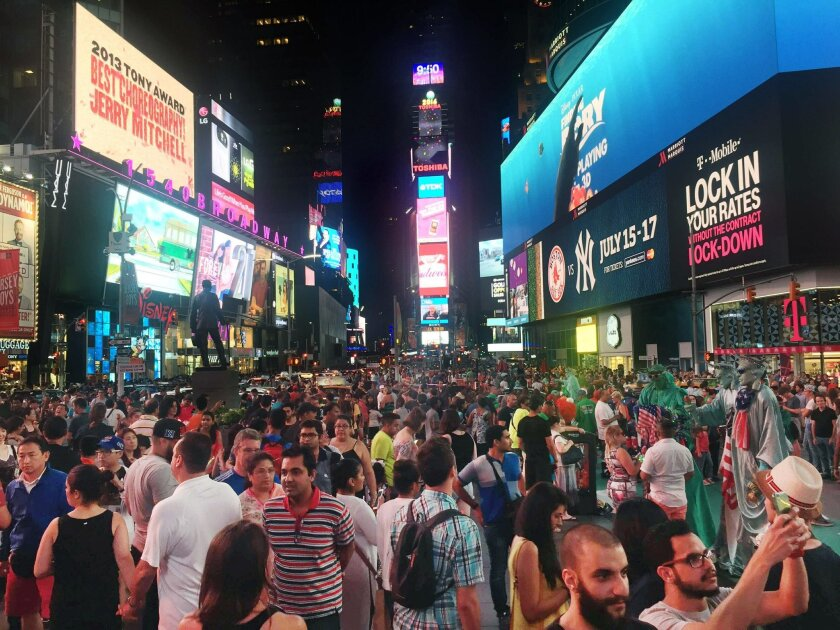 In this Saturday, July 16, 2016, photo, crowds of visitors linger in New York's Times Square. The truck bombing in Nice on July 14 may cause some people to avoid large crowds for fear of more terrorist attacks. (AP Photo/William Mathis)