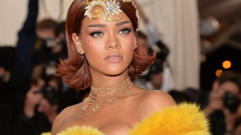 "Rihanna arrives at The Metropolitan Museum of Art's Costume Institute benefit gala celebrating ""China: Through the Looking Glass"" on Monday, May 4, 2015, in New York. (Photo by Evan Agostini/Invision/AP) (/ The Associated Press)"