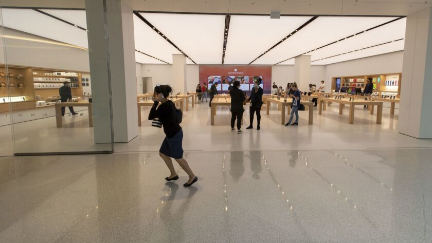 BEVERLY HILLS, CALIF. -- WEDNESDAY, OCTOBER 24, 2018: A shopper runs past the Apple store at The Be