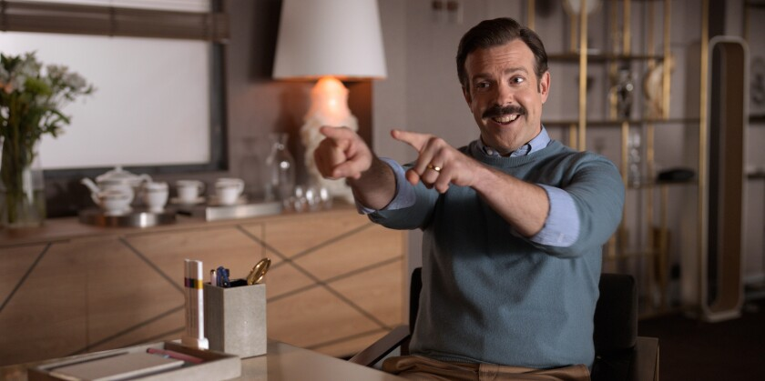 """This image released by Apple TV Plus shows Jason Sudeikis in """"Ted Lasso,"""" premiering globally on Friday, August 14, on Apple TV Plus. (Apple TV Plus via AP)"""