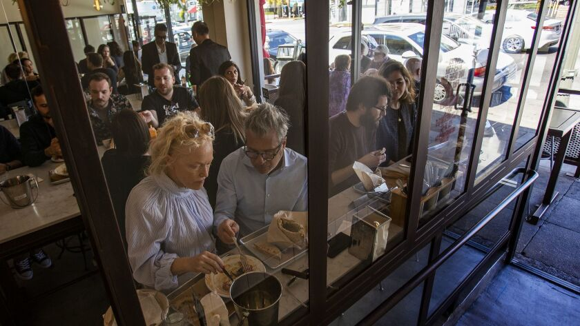 LOS ANGELES, CA - MARCH 15, 2019: Every seat is taken during the lunch rush for Mediterranean food a