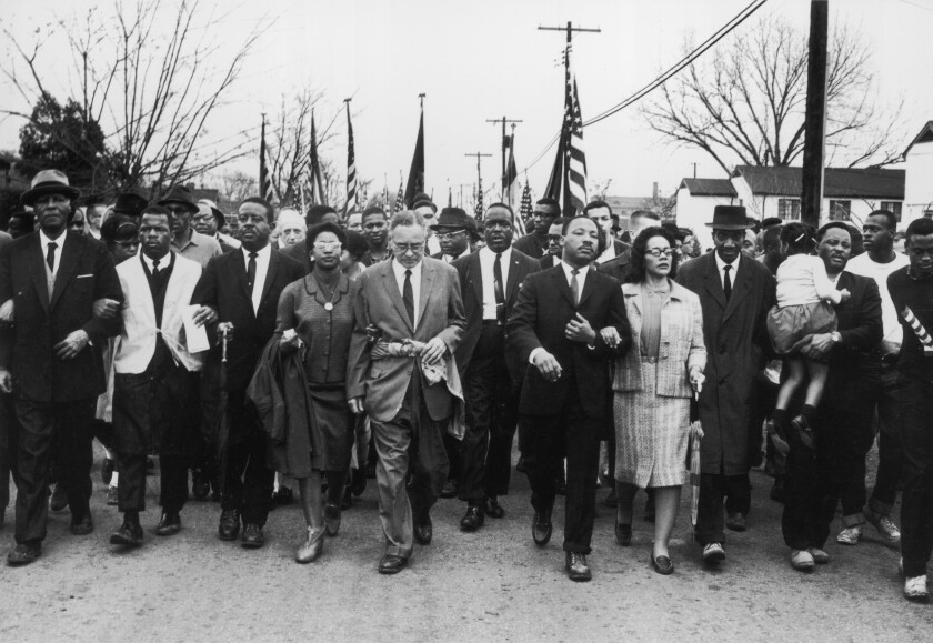 John Lewis, second from left, march from Selma, Ala., to Montgomery in 1965 with leaders including Martin Luther King Jr.